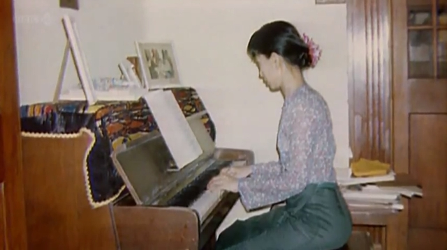Aung San Suu Kyi at the piano