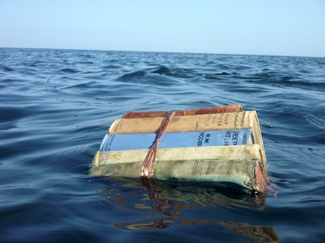 Books Floating On Ocean