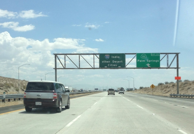 Highway sign reading 'Indio / other desert cities'