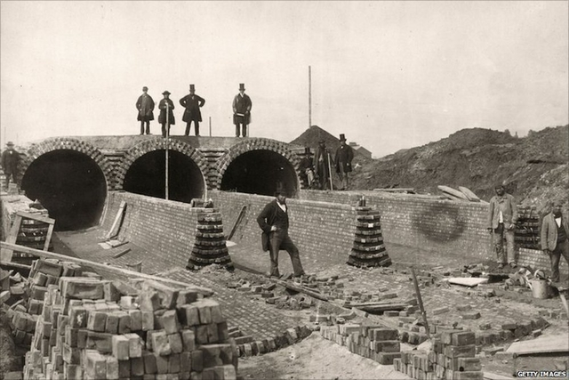 Photo of Bazalgette surveying sewer